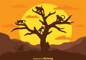 Siluetas de mono en un árbol