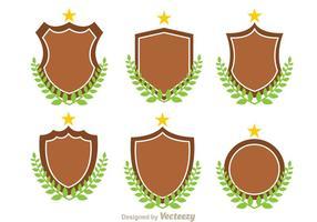 Vetores de escudos e folhas