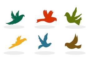 Vetores da silhueta dos pássaros voadores