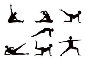 Sillhouette del yoga del embarazo