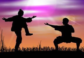 Mann macht Wushu in Silhouette