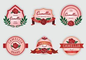camelia flores de color rosa vector de la etiqueta