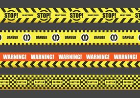 Vetores fita de aviso vermelho e amarelo