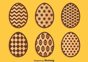 Ovos de Páscoa de chocolate sobre vetores laranja