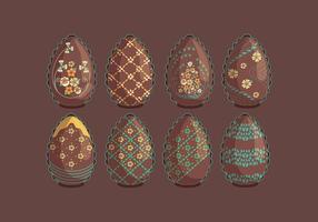 Ovos de Páscoa de chocolate do vintage com flores vetores