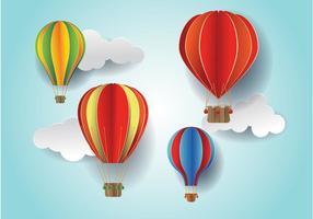 Papel cortado colorido globo de aire caliente y vectores de nubes