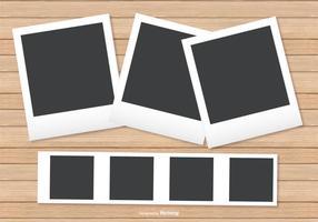 Polaroid Frames on Wood Background