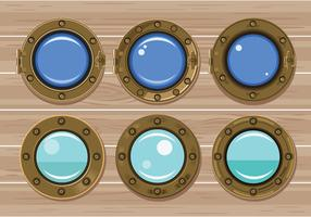 Set of Gold Porthole or Ship Window on Wood Background