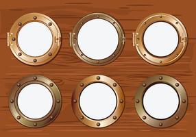 Gold Porthole or Ship Window on Wood Background