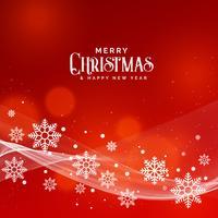 Hermoso fondo rojo para el festival de Navidad con copos de nieve