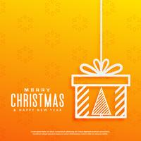 sfondo giallo con albero di Natale all'interno di un design di scatola regalo