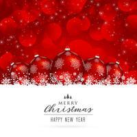 élégant rouge joyeux Noël voeux avec des boules et de la neige