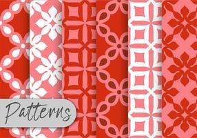 Conjunto de patrones geométricos rojos