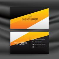 Moderna tarjeta de visita amarilla y negra con formas limpias.