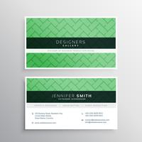 Elegante tarjeta de visita verde minimalista con patrón de formas geométricas.