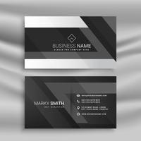 black business card with abstract shapes