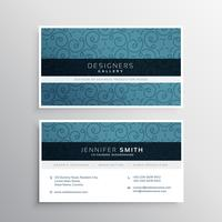 blue business card with abstract floral pattern