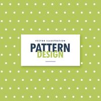 green background with white polka dots pattern