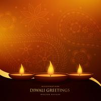 happy diwali beautiful greeting with three diya and paisley deco