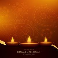 feliz diwali hermoso saludo con tres diya y paisley deco