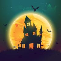 haunted hause of halloween in front of moon