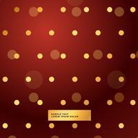 röd bakgrund med gyllene polka prickar