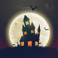 läskigt hemsökt halloween hus framför månen