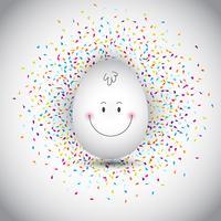 Oeuf de Pâques sur fond de confettis