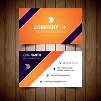Tarjeta de visita corporativa naranja y azul marino