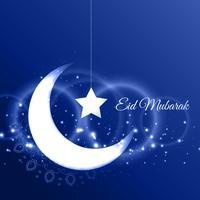 Tarjeta de eid mubarak con luna creciente sobre fondo azul