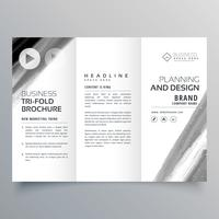 tri fold brochure vector template design with black paint stroke