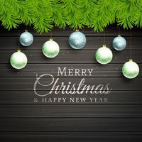 bolas de Natal e pinheiro folhas sobre fundo de madeira