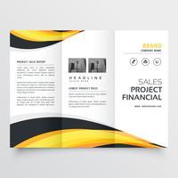 Diseño de folleto tríptico con ondas amarillas y negras.