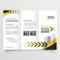 fantastisk tri fold broschyrdesign i gula svarta former med arr