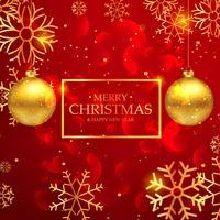 fantastiskt rött glatt julkort med hängande gyllene ba