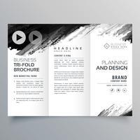 modelo de apresentação de três dobras tinta preta abstrata para sua marca
