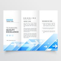 tri-fold business brochure with geometric blue shapes and arrow