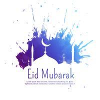 Saludo de eid mubarak con salpicaduras de tinta azul y mezquita silhouett