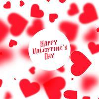 vacker valentinsdag bakgrund med röda suddiga hjärtan