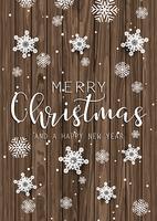 Texto de Natal e flocos de neve na textura de madeira