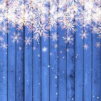 Flocos de Neve em fundo de madeira