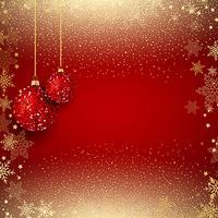 Colgando adornos brillantes sobre un fondo de confeti dorado