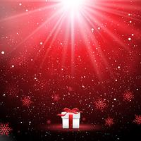 Regalo de Navidad en un fondo de copo de nieve