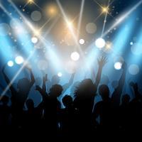 Party människor på en bakgrundsbelysning bakgrund