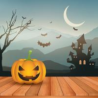 Halloween-pompoen tegen griezelig landschap