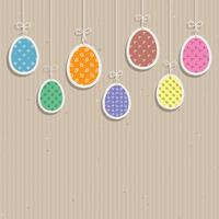 Easter eggs on cardboard texture