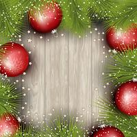 Christmas background with pine tree branches and baubles