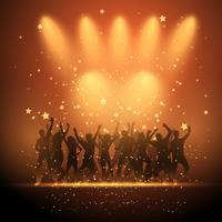La gente che balla su sfondo riflettori