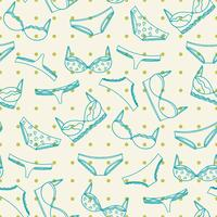 Underwear seamless pattern with green dots. Bras and panties illustration.