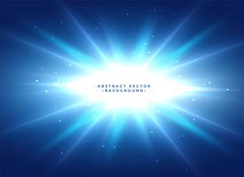 blå bakgrund med glänsande stjärnbrista
